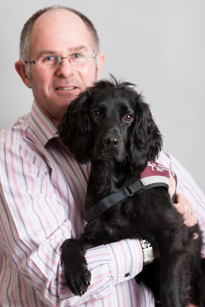 Richard with hearing dog Dillon