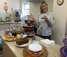 Volunteer with cakes