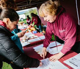 Signing in at a Hearing Dogs event