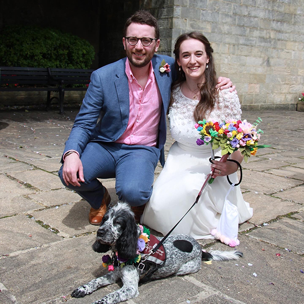 Clare with her husband and hearing dog Molly on her wedding day