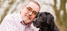 Chris with his hearing dog Rom