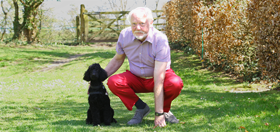 hearing dog poodle Micky deaf person Tim Stanley