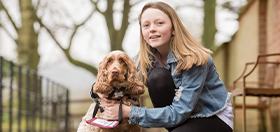 Ameila and her hearing dog, cocker spaniel Scamp