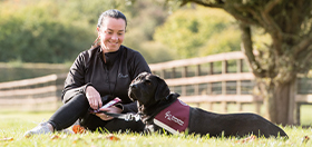 Lisa and her black labrador hearing dog
