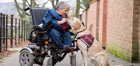 Sally and hearing dog Labrador