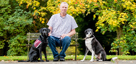 Steve and hearing dog Labrador