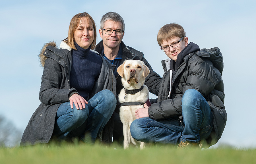 Oscar Williamson with mum Hilary, dad Paul and hearing dog Rosie