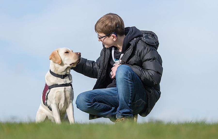 Oscar Williamson and hearing dog Rosie