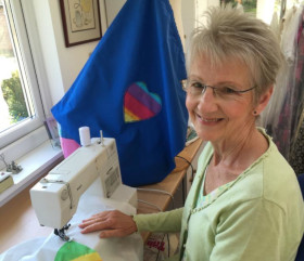 Volunteer with sewing machine