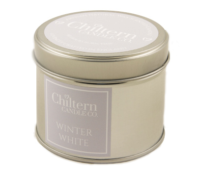 "Candle in a silver lidded tin, with a grey label that reads ""Winter White"""