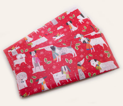 Red tissue paper with cartoon dogs wearing scarves repeating throughout