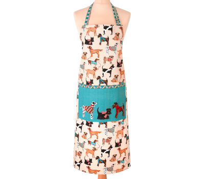 Full length cream apron, decorated with images of dogs wearing scarves and jumpers. The front pocket has a blue background with three dogs printed on it