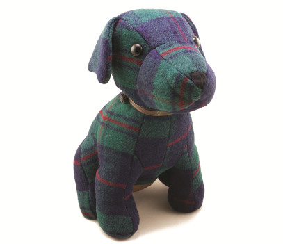 A dark green, red and blue tweed dog doorstop wearing a brown collar