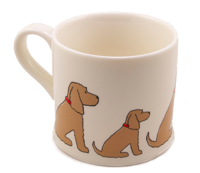 white mug with sitting golden cocker spaniels of various sizes around the outside