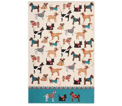 Cream coloured tea towel with images of dogs wearing coats all over