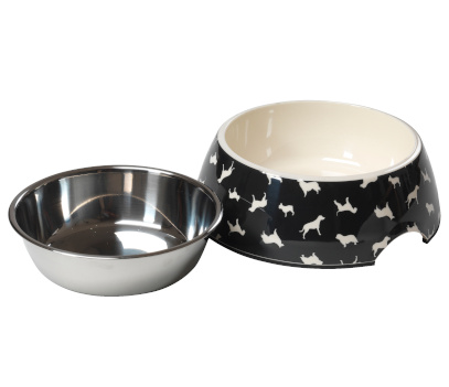 A stainless steel dog bowl beside a black dog bowl with cream interior. Te black bowl has a repeating dog pattern on the outside.