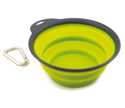 Lime green collapsible bowl in its opened state, with metal clip
