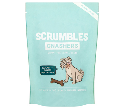 "BLue bag bag with text ""Scrumbles Gnashers, grain free dental bones"". There is a picture of a dogs looking at a bone"