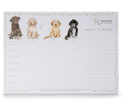 weekly planner with four illustrated dogs along the top