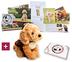 Welcome pack with cuddly toy dog and notepad with sponsorship logo