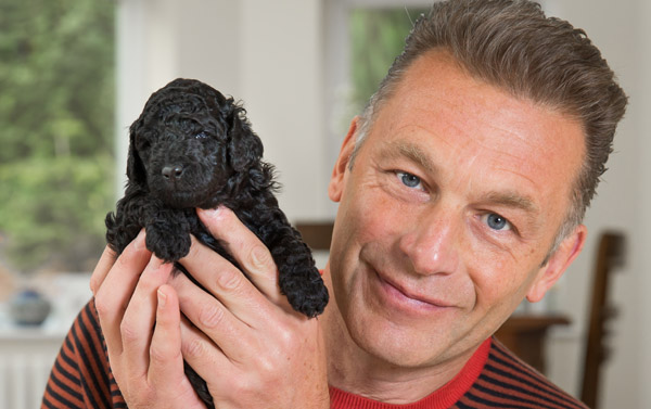Chris Packham with an adorable puppy