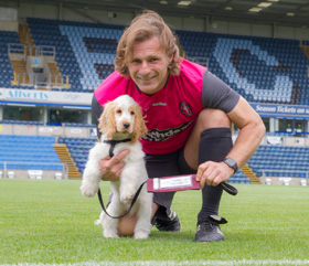 Footballer and HD Puppy